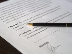 A contract with a pen.