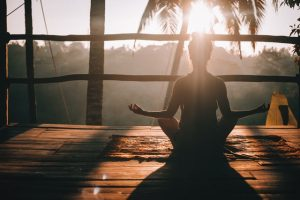 A woman who is meditating while taking a break due to the fears she has about selling her home