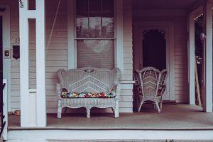 White wicker sofa on a porch.