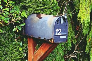 Blue rusted mailbox with number 12.