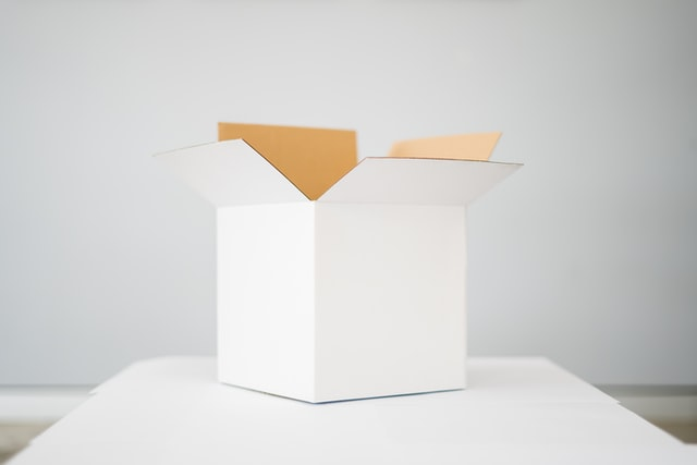 An empty white moving box.