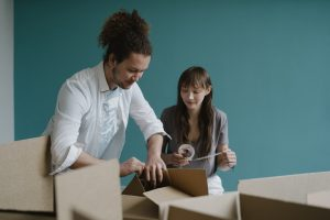 A man and a woman packing up boxes
