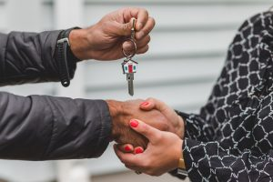 Woman shaking hand with a real estate agent