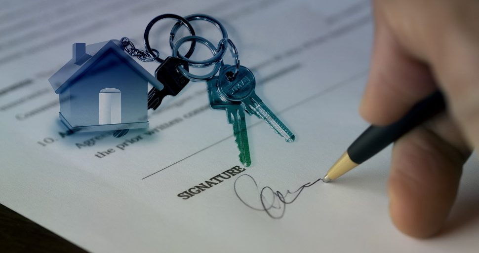Signing a house sale contract